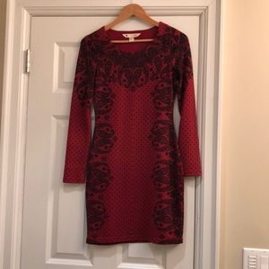 Red and black patterned sweater dress